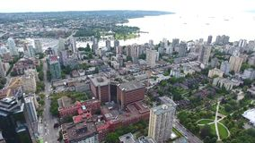 Stunning 4k aerial panorama of modern urban Vancouver financial district downtown with skyscraper architecture by water stock footage