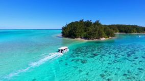 Stunning 4k aerial view on small tourist boat sailing in turquoise Pacific ocean water Tahiti French Polynesia seascape. Stunning aerial view on small tourist stock footage