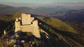 Stunning 4k approach aerial, countryside castle ruins on hilltop, Abruzzo Italy stock video footage