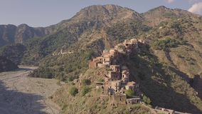 Stunning 4k cinematic aerial over abandoned ghost town of Roghudi Calabria Italy stock footage