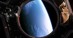 A stunning 4K view of planet earth as viewed by an astronaut who is watching it through the windows of his space shuttle. stock footage