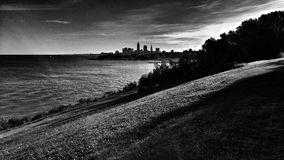 Stunning Lake Erie and Cleveland Skyline. Black and white early autumn on Lake Erie. The amazing view from Edgewater Park shows the beach and skyline and Ohio's Royalty Free Stock Photo