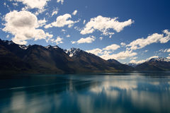 Stunning Lake Wakatipu. Reflection from Lake Wakatipu surrounded by mountains near Queenstown, South Island, New Zealand Royalty Free Stock Photos