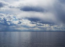 Stunning landscape of blue sea and cloudy sky royalty free stock photos