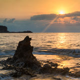 Stunning landscape dawn sunrise with rocky coastline and long ex. Dawn sunrise landscape over beautiful rocky coastline in Mediterranean Sea Royalty Free Stock Photography