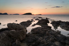 Stunning landscape dawn sunrise with rocky coastline and long exp Royalty Free Stock Image