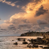 Stunning landscape dawn sunrise with rocky coastline and long exp Royalty Free Stock Photo