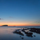 Stunning landscape dawn sunrise with rocky coastline and long exp. Dawn sunrise landscape over beautiful rocky coastline in Mediterranean Sea Royalty Free Stock Images