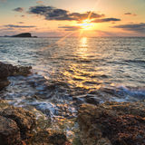 Stunning landscape dawn sunrise with rocky coastline and long exp. Dawn sunrise landscape over beautiful rocky coastline in Mediterranean Sea Royalty Free Stock Photography