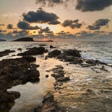 Stunning landscape dawn sunrise with rocky coastline and long exp. Dawn sunrise landscape over beautiful rocky coastline in Mediterranean Sea Royalty Free Stock Photos