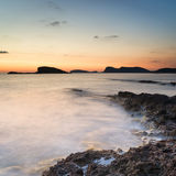 Stunning landscape dawn sunrise with rocky coastline and long exp. Dawn sunrise landscape over beautiful rocky coastline in Mediterranean Sea Royalty Free Stock Image