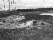 Levee. A stunning landscape and drainage levee for an industrial area royalty free stock images