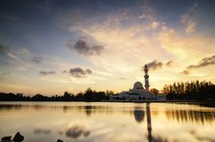 Stunning landscape floating mosque at Terengganu, Malaysia over golden sunset background Royalty Free Stock Photography
