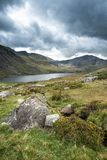 Stunning landscape image of countryside around Llyn Ogwen in Sno. Beautiful landscape image of countryside around Llyn Ogwen in Snowdonia during early Autumn royalty free stock image