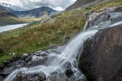 Stunning landscape image of countryside around Llyn Ogwen in Sno stock images