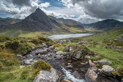 Stunning landscape image of countryside around Llyn Ogwen in Sno. Beautiful landscape image of stream near Llyn Ogwen in Snowdonia during early Autumn flowing royalty free stock photography