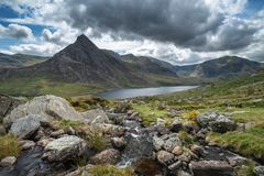Stunning landscape image of countryside around Llyn Ogwen in Sno. Beautiful landscape image of stream near Llyn Ogwen in Snowdonia during early Autumn flowing royalty free stock photos