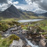 Stunning landscape image of countryside around Llyn Ogwen in Sno. Beautiful landscape image of stream near Llyn Ogwen in Snowdonia during early Autumn flowing stock images