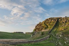 Beautiful landscape image of Hadrian`s Wall in Northumberland at. Stunning landscape image of Hadrian`s Wall in Northumberland at sunset with fantastic late Royalty Free Stock Photography