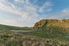 Beautiful landscape image of Hadrian`s Wall in Northumberland at. Stunning landscape image of Hadrian`s Wall in Northumberland at sunset with fantastic late Stock Photos