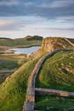 Beautiful landscape image of Hadrian`s Wall in Northumberland at. Stunning landscape image of Hadrian`s Wall in Northumberland at sunset with fantastic late Stock Image