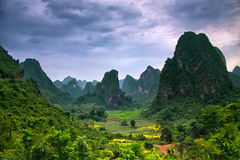 Stunning landscape - lost world in mountains. Under soft blue-pinkish soft sunset sky Stock Image
