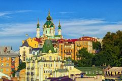 Stunning landscape of the Saint Andrew`s Church and ancient buildings of Andrew`s Descent Andriyivsky uzviz. Podil neighborhood. Vibrant blue sky at the royalty free stock photography