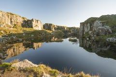 Stunning landscape sunset image over abandoned Foggintor Quarry. Beautiful landscape sunset image over abandoned Foggintor Quarry in Dartmoor with raking soft stock images