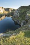 Stunning landscape sunset image over abandoned Foggintor Quarry. Beautiful landscape sunset image over abandoned Foggintor Quarry in Dartmoor with raking soft royalty free stock photography