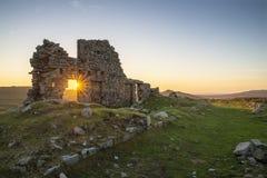 Stunning landscape sunset image over abandoned Foggintor Quarry. Beautiful landscape sunset image over abandoned Foggintor Quarry in Dartmoor with raking soft royalty free stock image