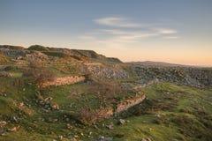 Stunning landscape sunset image over abandoned Foggintor Quarry. Beautiful landscape sunset image over abandoned Foggintor Quarry in Dartmoor with raking soft royalty free stock photos