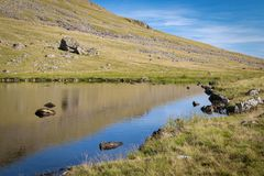 Stunning landscape view of Greendale Tarn in the Lake District N. Ational Park in the UK on a beautiful sunny summer day stock photos