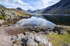 Stunning landscape of Wast Water with reflections in calm lake w Royalty Free Stock Photo