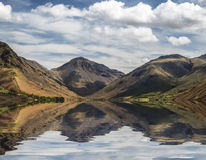 Stunning landscape of Wast Water with reflections in calm lake w Stock Photography