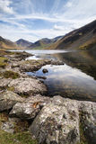 Stunning landscape of Wast Water with reflections in calm lake w Stock Images