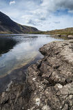 Stunning landscape of Wast Water with reflections in calm lake w Royalty Free Stock Image