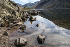 Stunning landscape of Wast Water with reflections in calm lake w Stock Photos