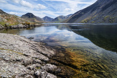 Stunning landscape of Wast Water with reflections in calm lake w Stock Image