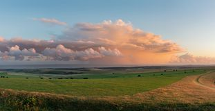 Stunning large panorama of Summer sunset landscape image of South Downs National Park in English countryside with stunning royalty free stock photo