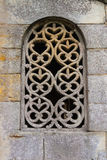 Stunning lattice window in pre-romanesque church Stock Image
