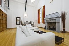 Stunning living room. Stunning historic building conversion with high ceiling and fireplace Stock Photography