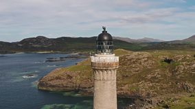Stunning long distance aerial shot part 02 of Ardnamurchan Point, Great Britains most westerly point, with lighthouse stock footage