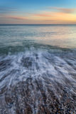 Stunning long exposure seascape image of calm ocean at sunset Royalty Free Stock Photography