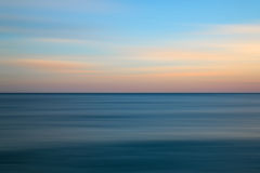 Free Stunning Long Exposure Seascape Image Of Calm Ocean At Sunset Stock Photo - 44562550