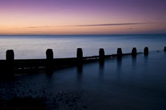Stunning long exposure sunrise over calm sea Royalty Free Stock Image