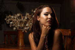 A stunning look. Seductive portrait of a stunning brunette woman in evening wear Royalty Free Stock Photography
