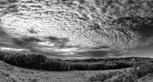 Beautiful mackerel sky cirrocumulus altocumulus cloud formations. Stunning mackerel sky cirrocumulus altocumulus cloud formations in Summer sky landscape black Royalty Free Stock Photography