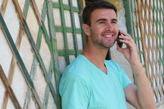 Stunning male calling by phone during summer vacation.  Stock Images