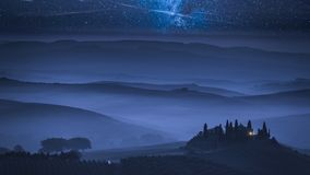Stunning milky way over foggy farm in Tuscany, Italy. Europe stock footage