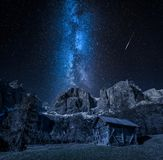 Stunning milky way over valley in Dolomites, Italy royalty free stock image